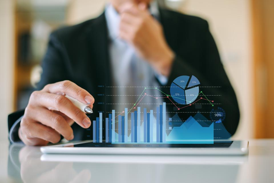Businessman investor analyzing company financial mutual fund report working with digital augmented reality graphics technology. Concept for business, economy and marketing.