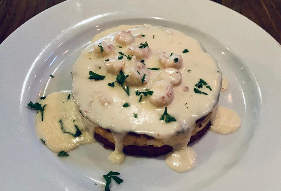 Alligator and Andouille Cheesecake Served at Cinclare Southern Bistro in Thibodaux, Louisiana and dripping in cheese.