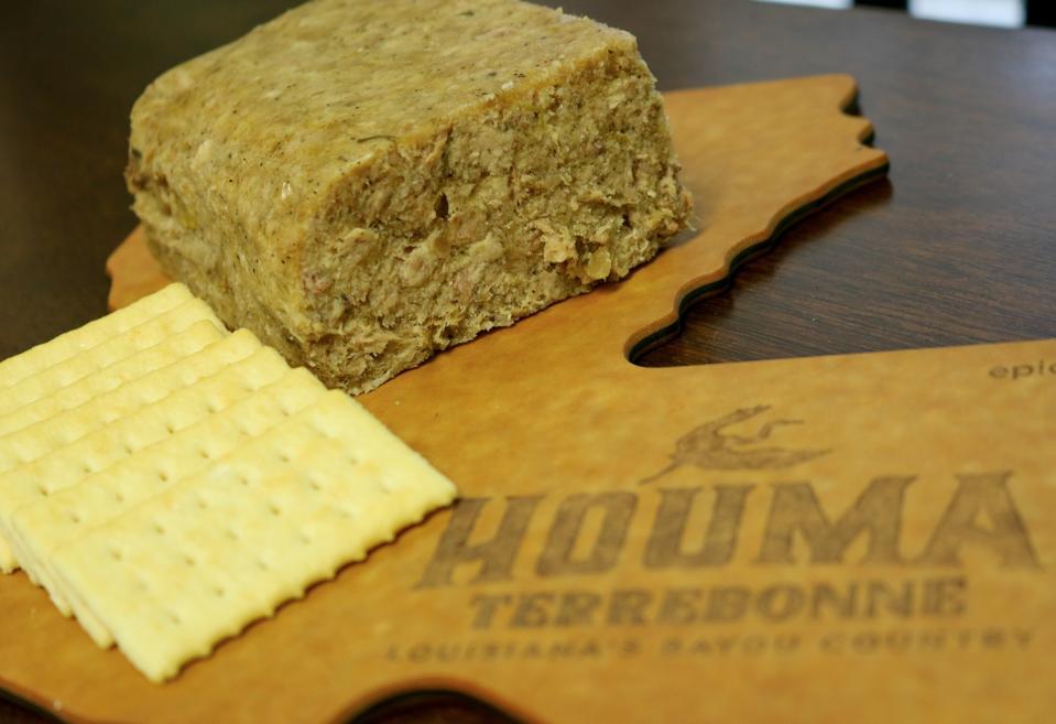 On a cutting board: Hogshead Cheese Served at Cajun Meat Market in Houma, Louisiana