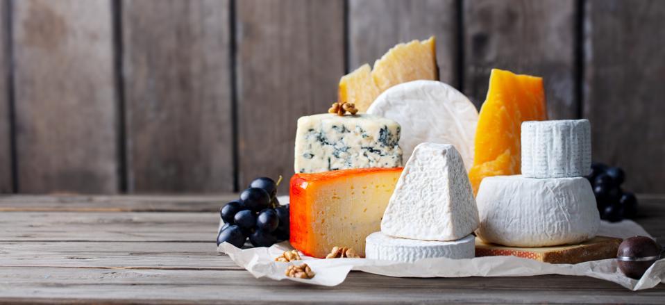 Cheese assortment: blue cheese, hard cheese, soft cheese.