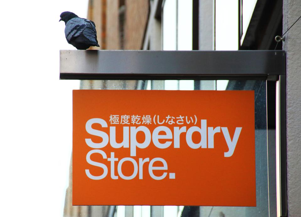 Superdry Store fashion brand logo seen in Cambridge...