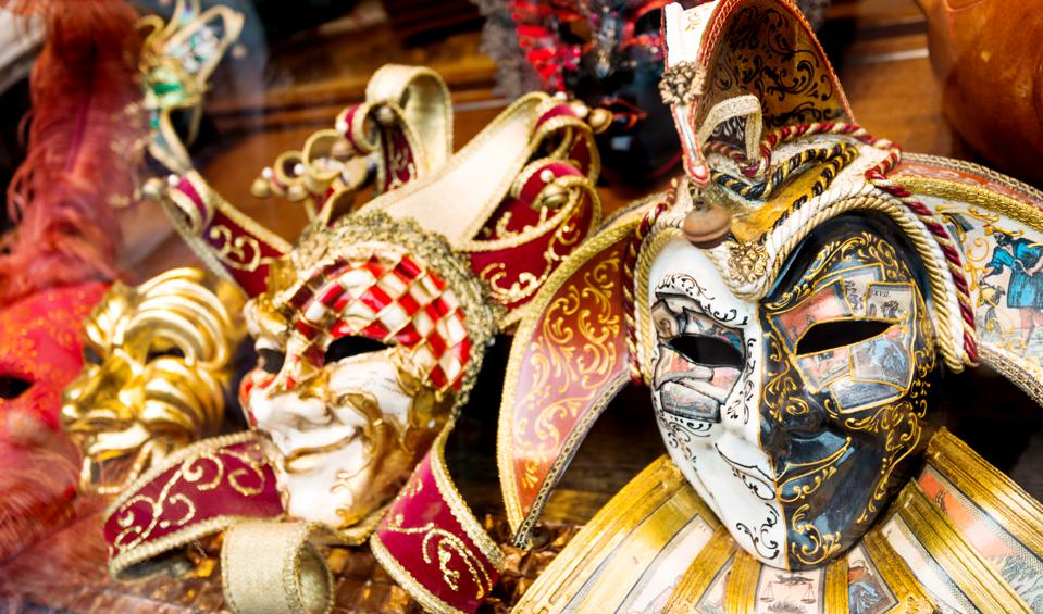 Venetian masks putting in a row