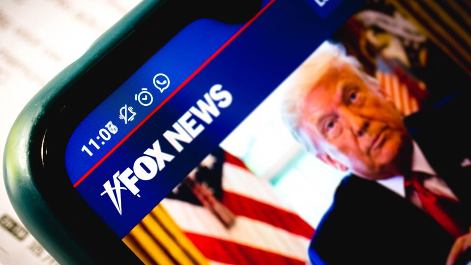 In this photo illustration the close-up of the Fox News...