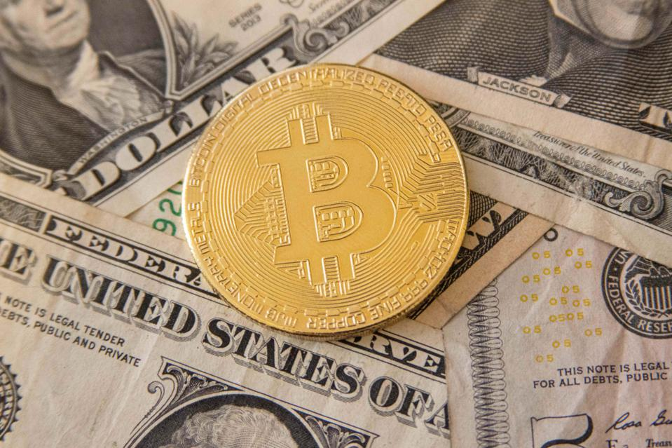 Bitcoin Illustration On United States Dollar USD Banknotes