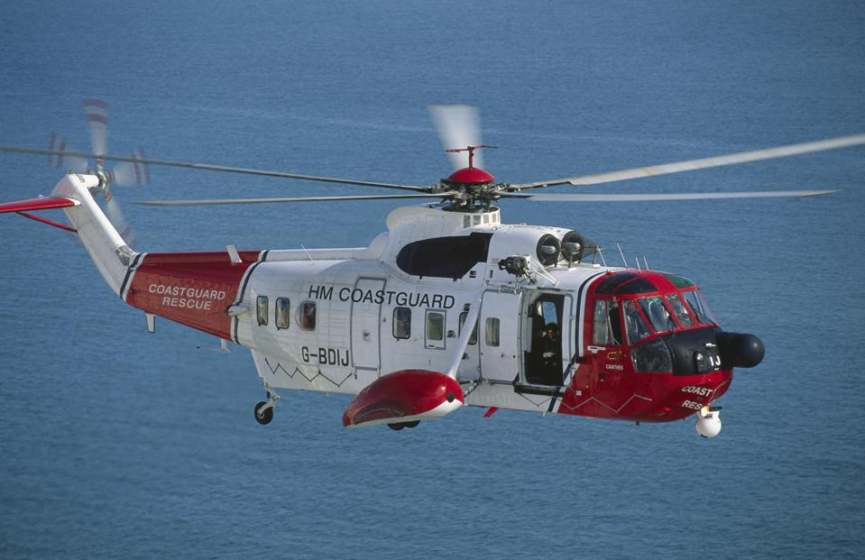 HM Coastguard Sikorsky S-61N flying enroute over the sea