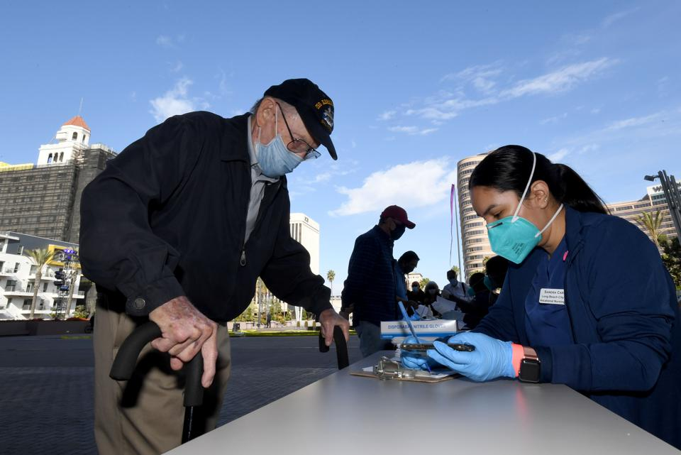 Long Beach opens mass vaccine site at convention center.