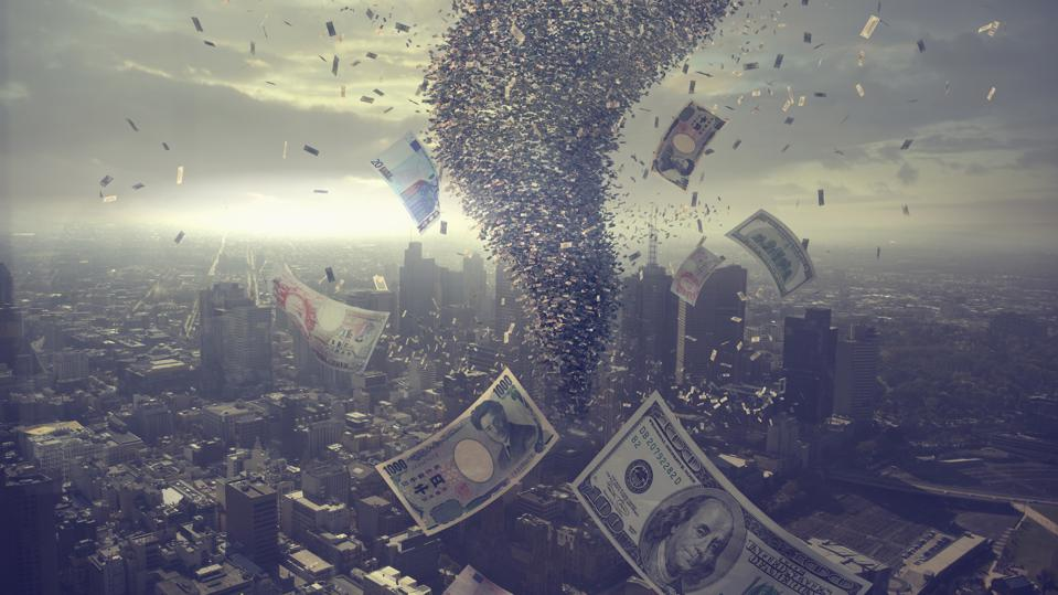 Tornado of money over cityscape