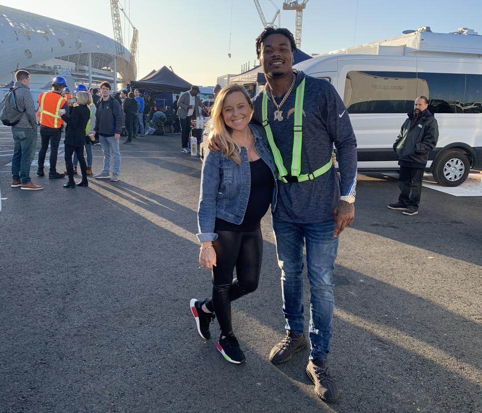NFL agent Savannah Foster with Chargers safety Derwin James, outside SoFI Stadium, 2020.