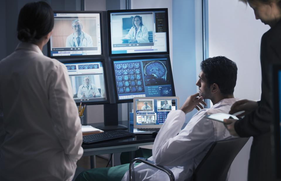 Doctors examining x-rays in video conference