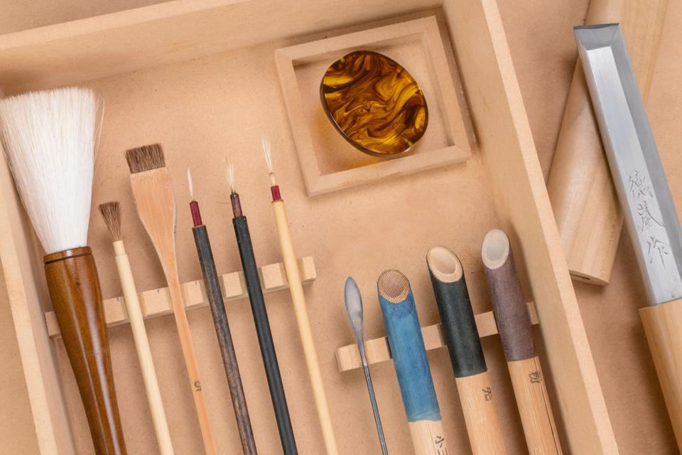 Traditional tools used in the creation of Namiki's lacquer pens.