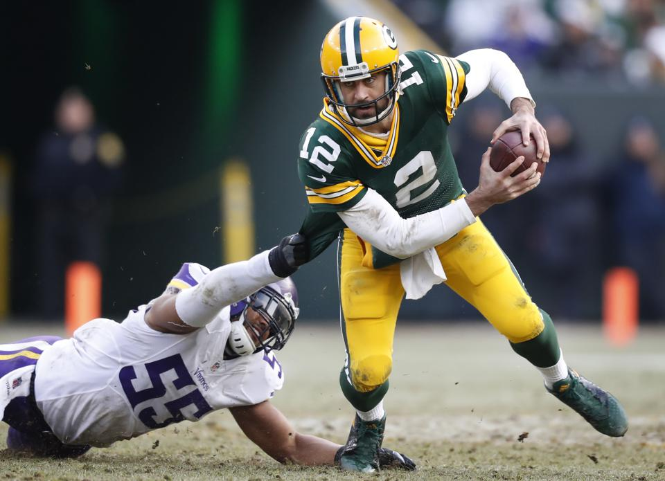 Green Bay Packers quarterback Aaron Rodgers (12) broke Minnesota Vikings outside linebacker Anthony Barr (55) at Lambeau Field Saturday December 24,2016 in Green Bay, WI
