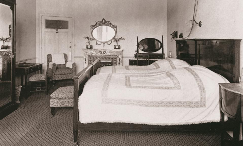 Black and white image of a guest room at the Palace hotel Madrid from 1912.