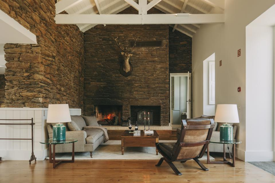 The main house at Ventozelo hotel in the Douro Valley, Portugal, has a big stone fireplace
