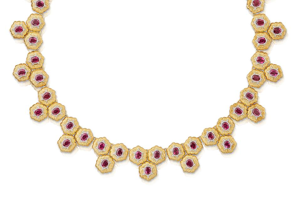 This gorgeous high-jewelry necklace features rigato engraving in yellow gold, as well as 57 rubies