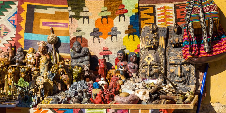 Wooden figurines for sale Ollantaytambo, Peru.