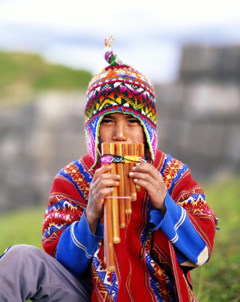 QUECHUA BOY PLAYING FLUTE, PERU