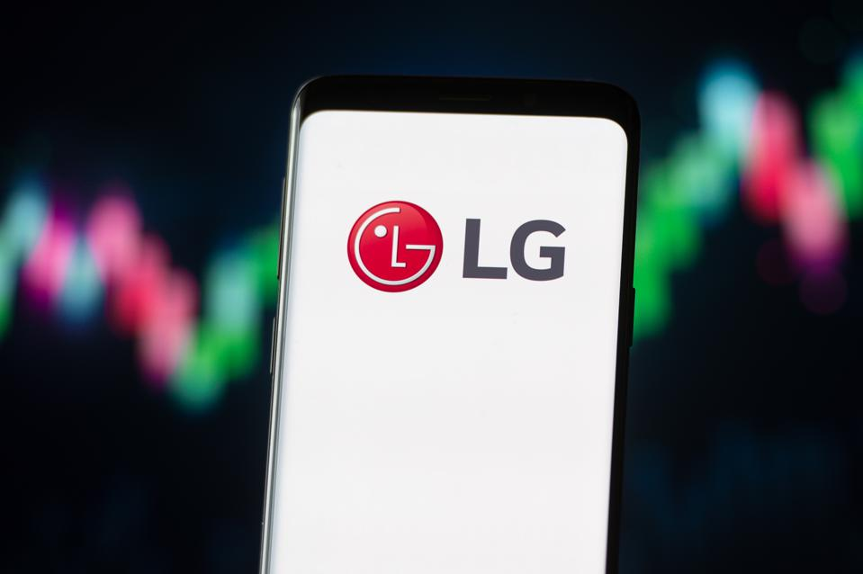 In this photo illustration a LG logo seen displayed on a...