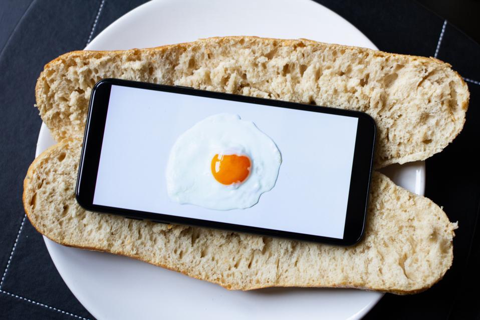 An Egg on a Phone on a Baguette