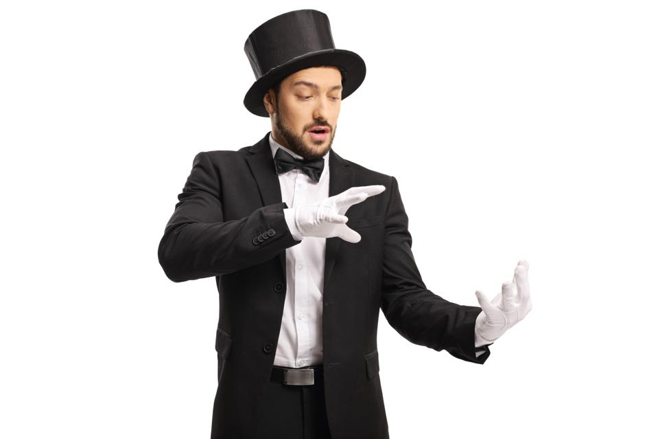 Magician wearing white gloves and performing a trick with his hands