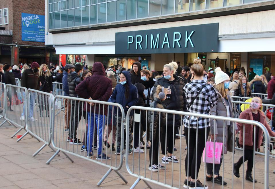 People queue outside the Primark store at the city centre.