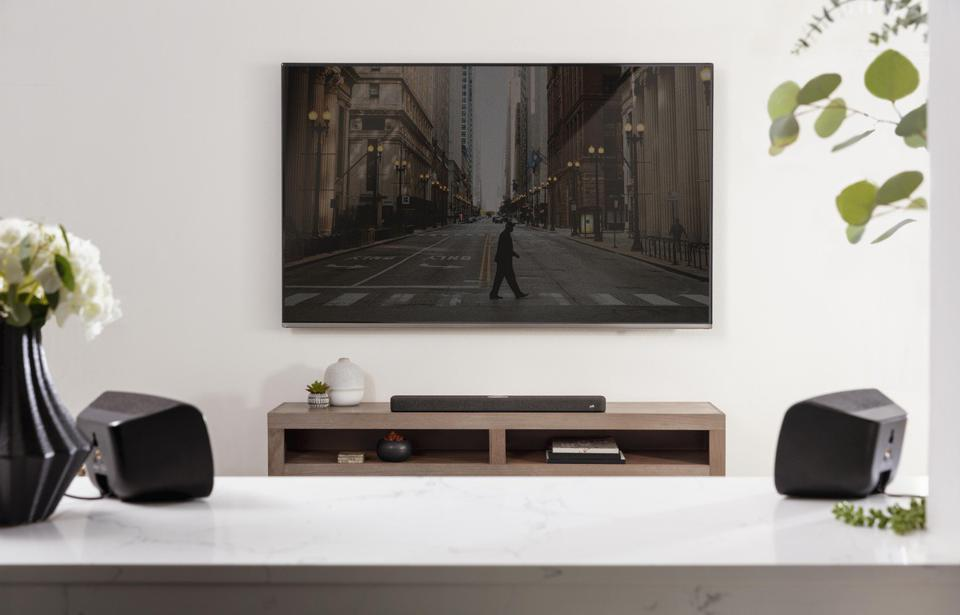 Polk Sr2 speakers in a living room with a flat-panel tv