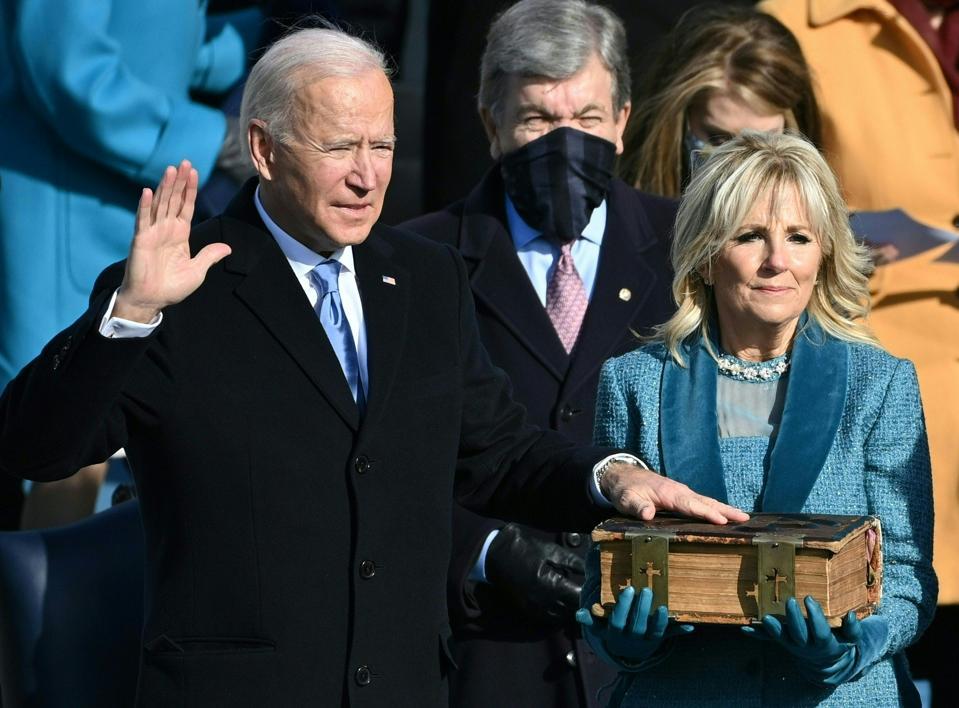 Joe Biden takes the oath of office as the 46th US President.