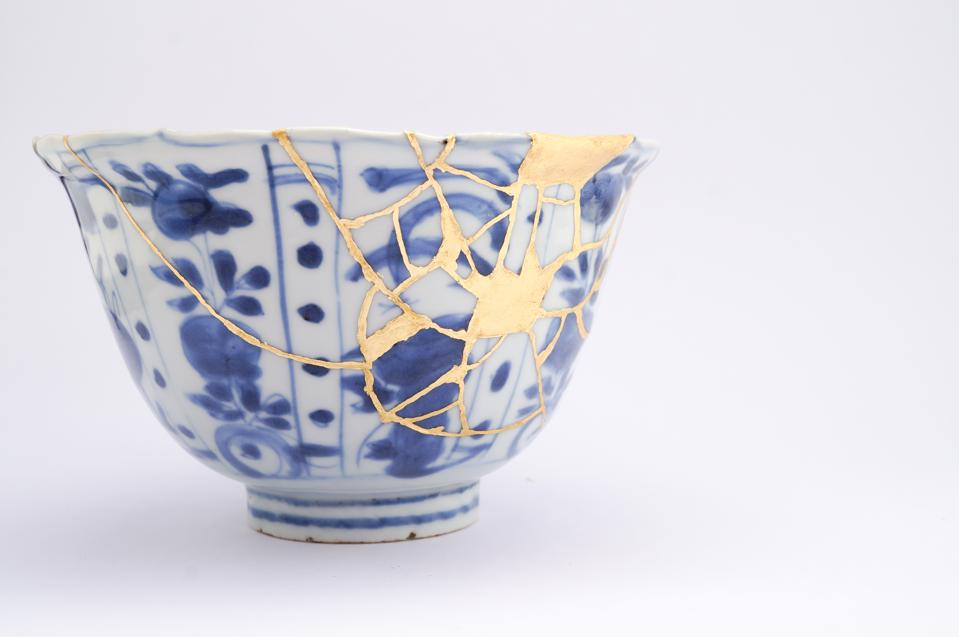 Antique broken Japanese blue bowl repaired with gold kintsugi technique