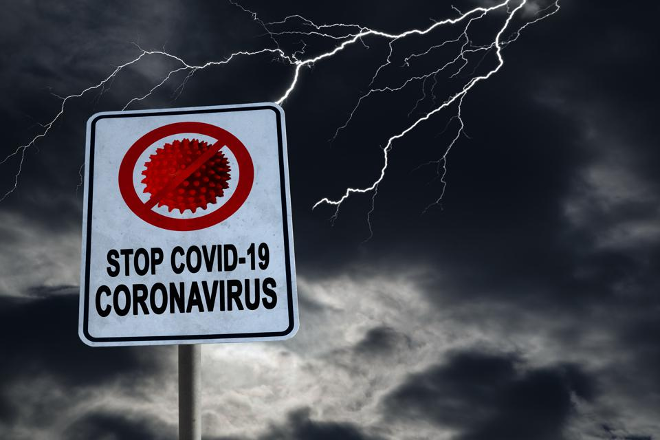 Stop Covid-19 Coronavirus Sign With Dramatic Sky and Copy Space