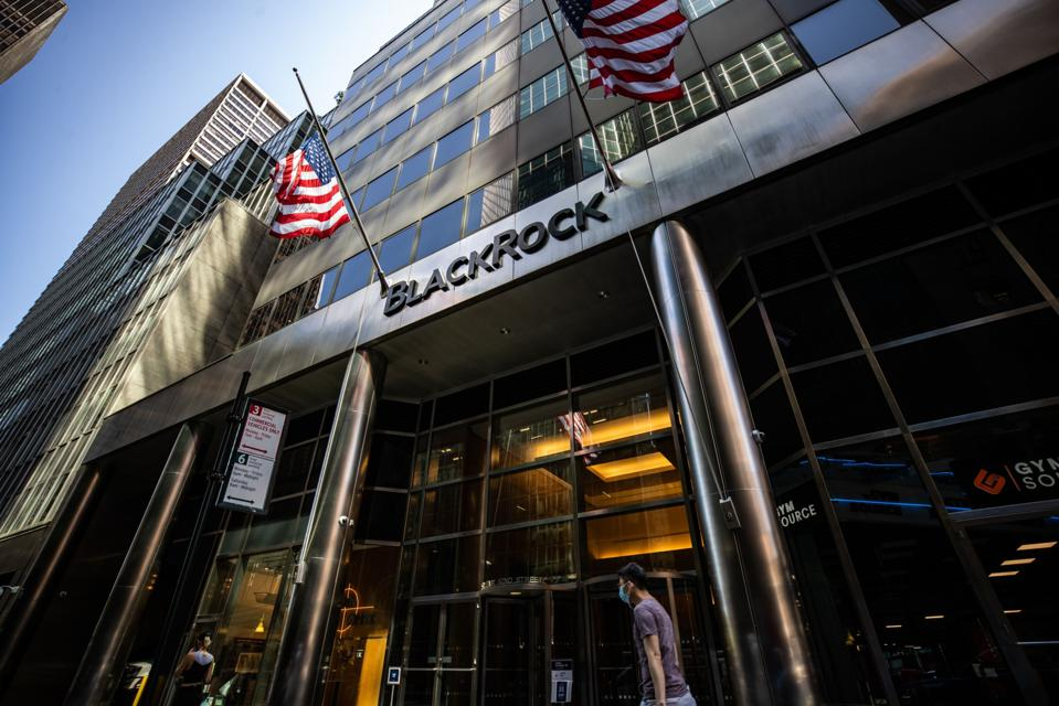 Pedestrians wearing protective masks walk past BlackRock Inc. headquarters in New York, U.S, on on Thursday, July 9, 2020. BlackRock is scheduled to release earnings figures on July 17.