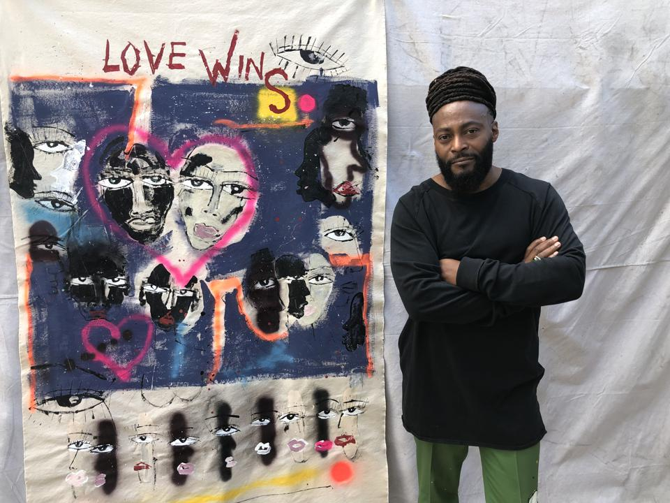 Artist Miles Regis and his work Love Wins