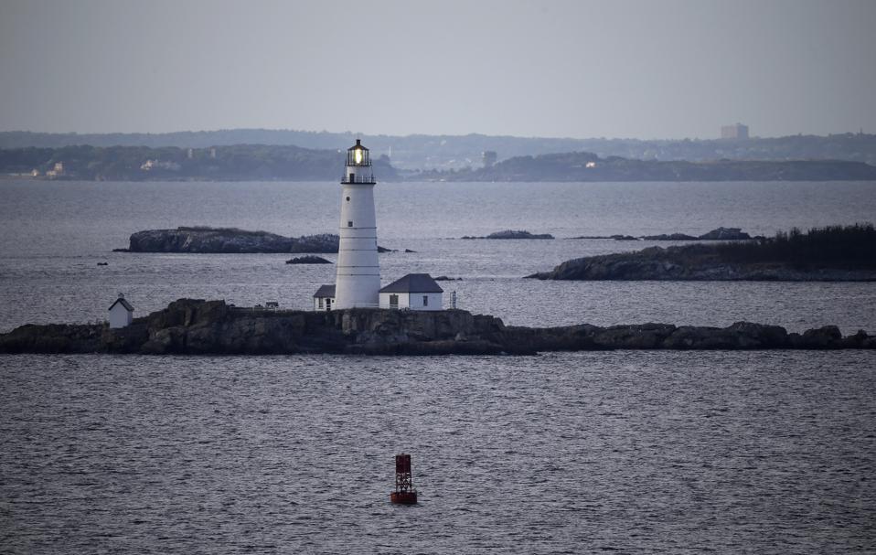 Boston Light flashes in Boston Harbor. (AP Photo/Elise Amendola)
