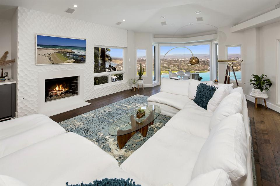 The living room inside 1904 Via Casa Alta in La Jolla, San Diego, CA