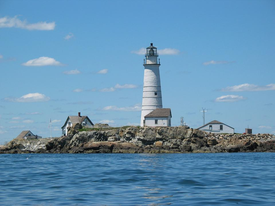 Boston Light stands above Little Brewster Island and flashes its light 27 miles across the Atlantic Ocean.