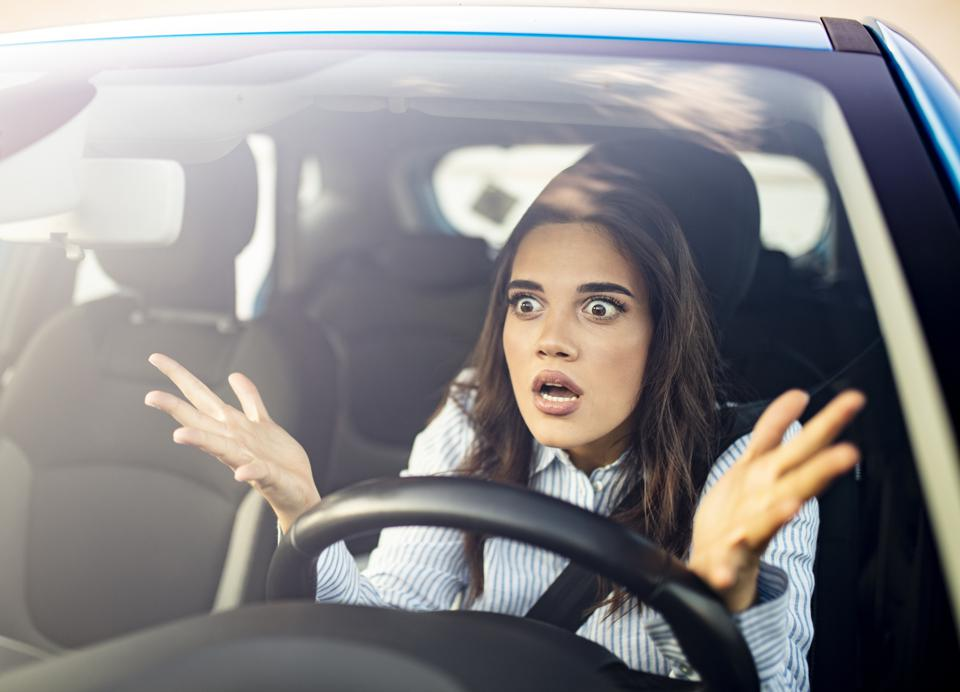 Frustrated woman stuck in traffic.