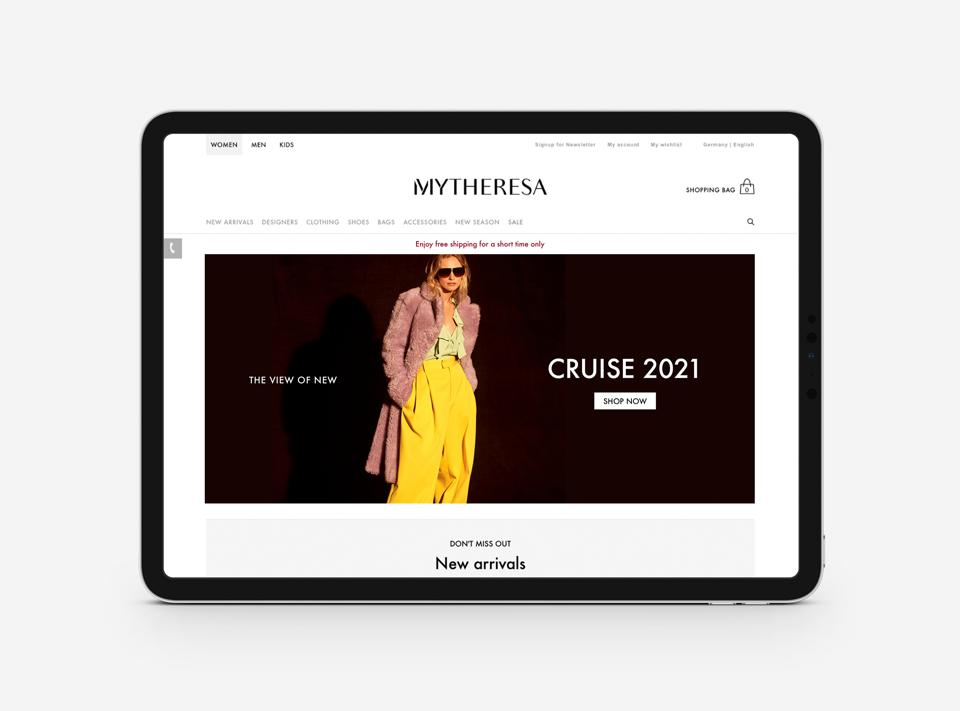 Mytheresa's home page featuring a look for cruise 2021.