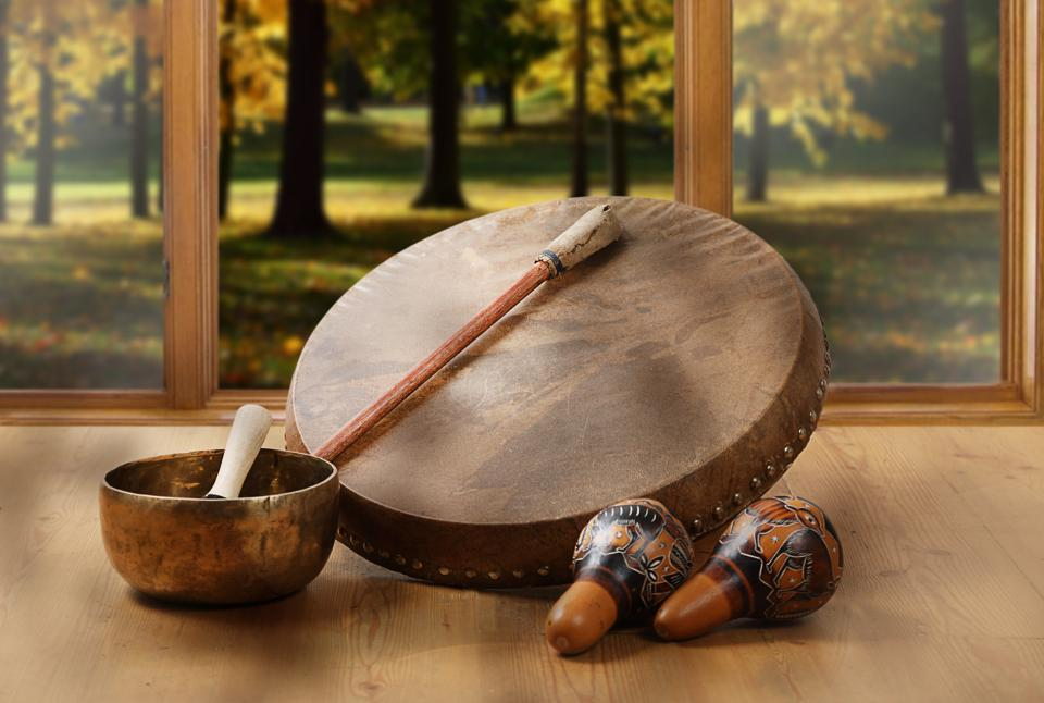 A still life of the shamanic drum, Tibetan singing bowls and maracas
