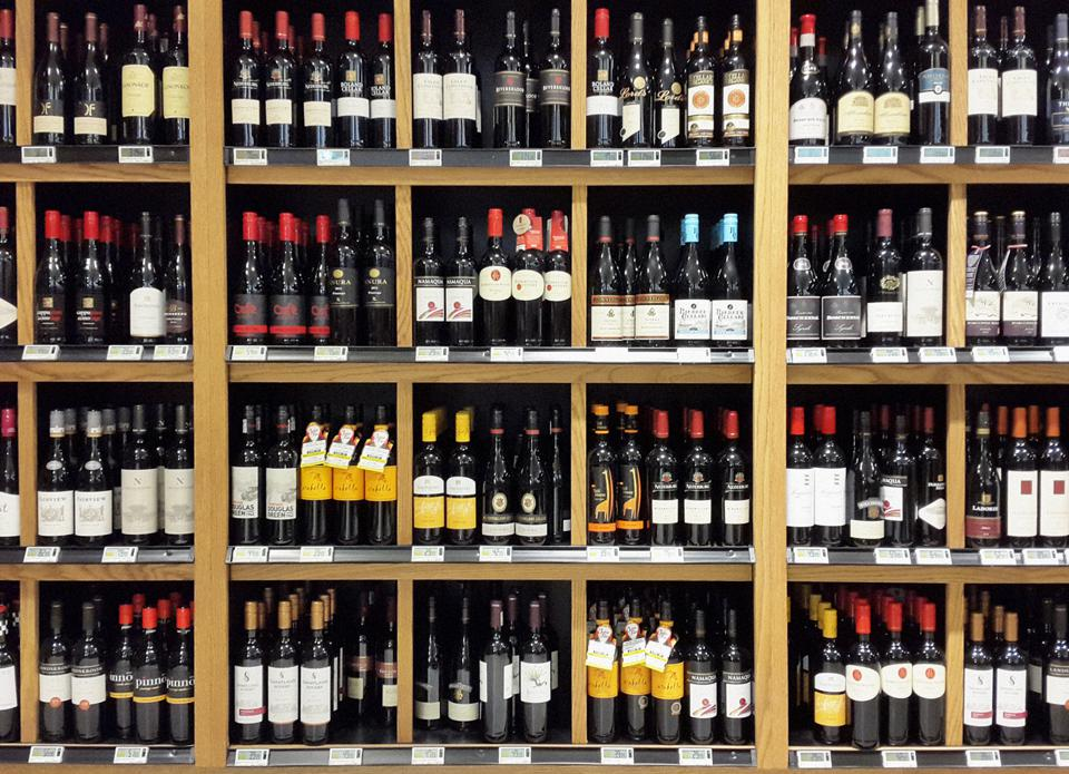 South African wines stacked on shelves in liquor store