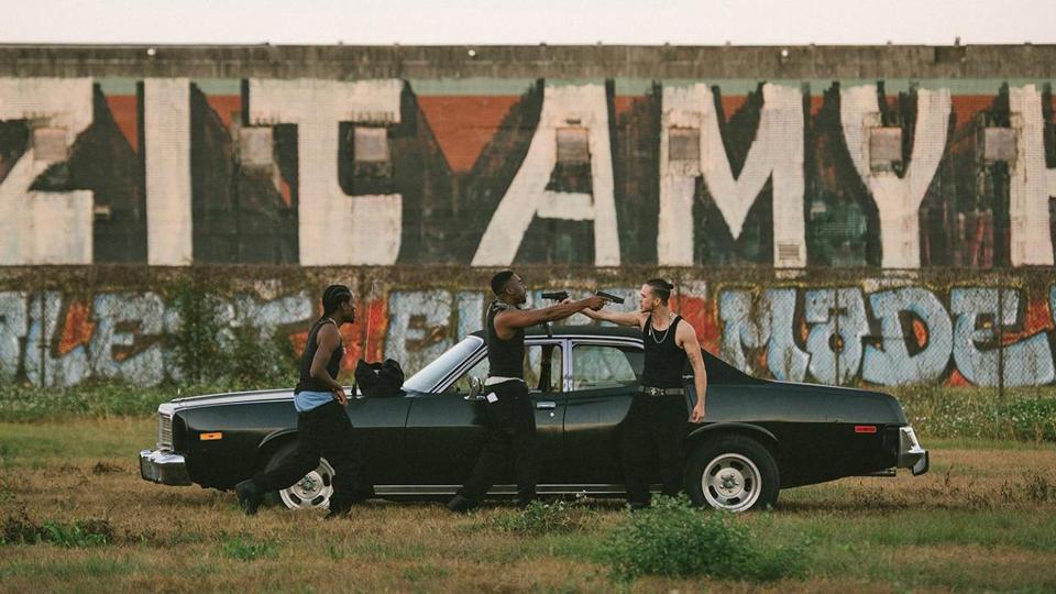 black car graffiti guns New Orleans