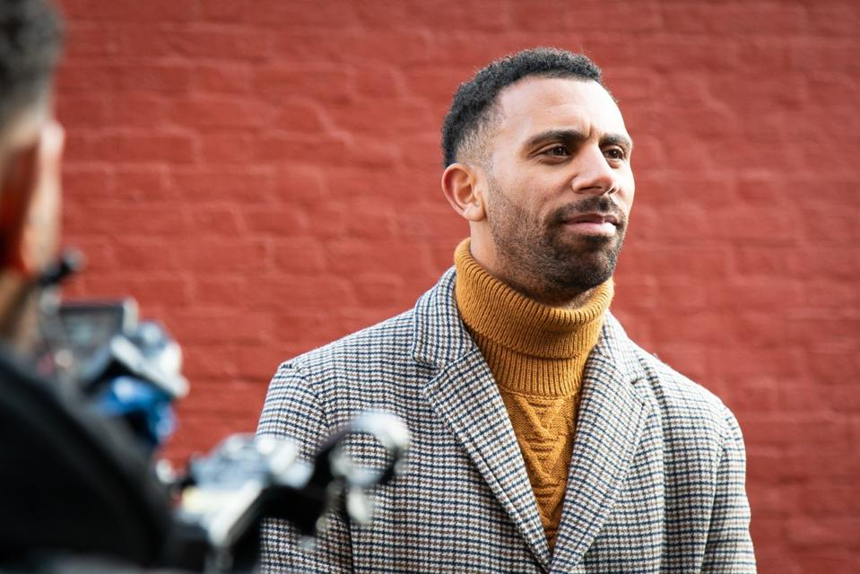 Image of Anton Ferdinand stood in from of a camera from the documentary Anton Ferdinand: Football, Racism and Me