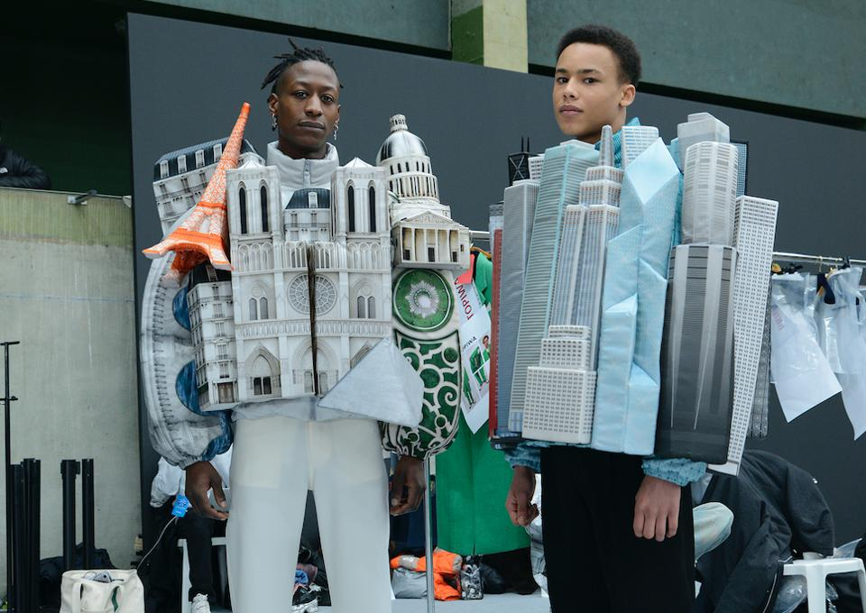 Two male models wearing jackets that depicted famous landmark buildings in New York and Paris