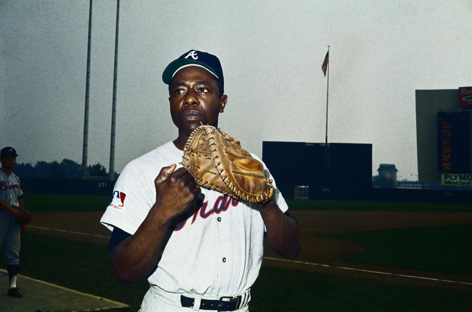Hank Aaron Holding Baseball Glove