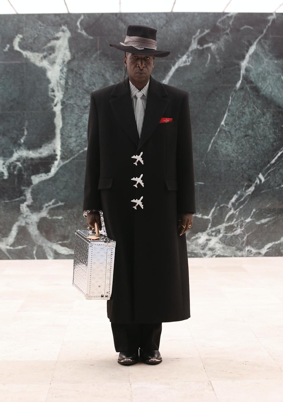 Saul Williams the American rapper, singer, songwriter, musician, poet, writer, and actor opened the Louis Vuitton show portraying James Baldwin.