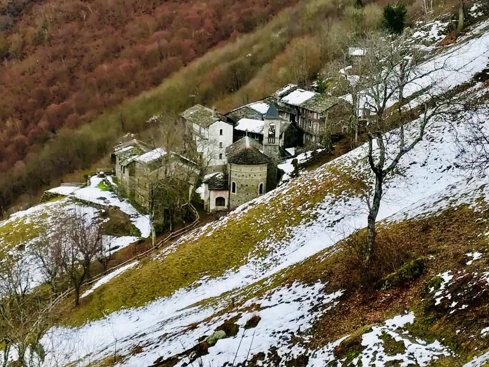bunch of old mountain stone dwellings