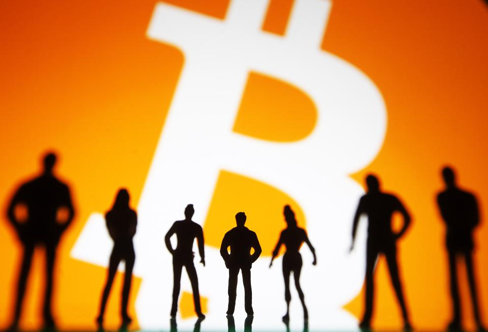 In this photo illustration, a Bitcoin logo is seen in front...