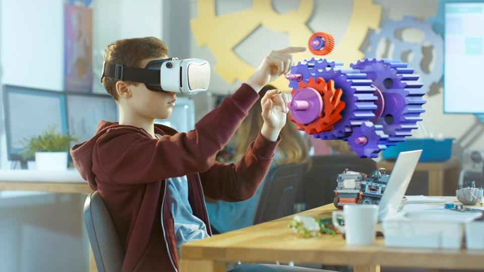 Boy Wearing Virtual Reality Headset Works in Interactive 3D Environment.