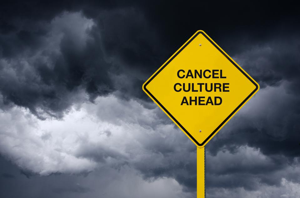 Cancel Culture Road Sign in front of dark storm clouds