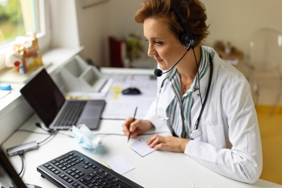 Doctor having online consultation with patient