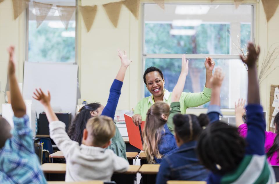 African-American teacher reading to school children
