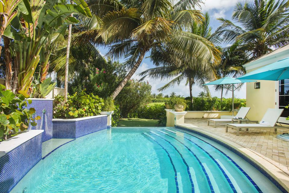The pool area at Exclusive Resorts, Grand Cayman.