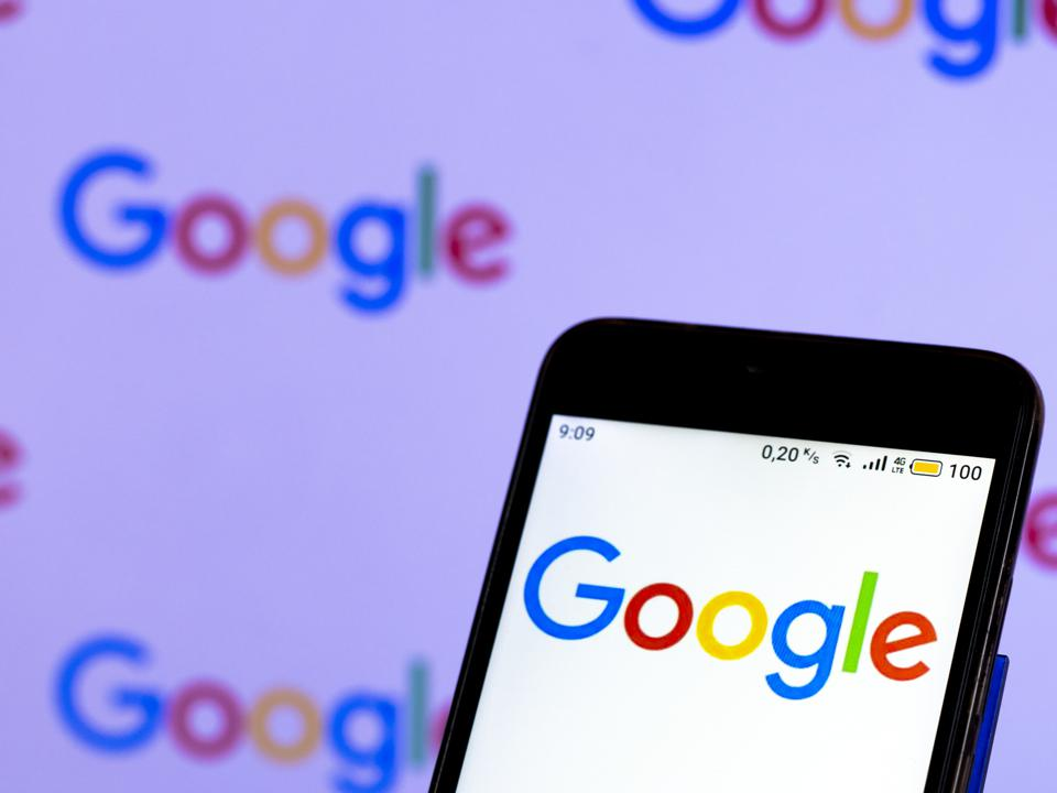 In this photo illustration, a Google logo seen displayed on...